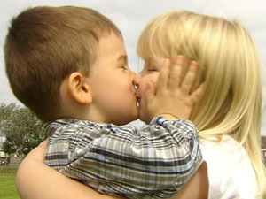 little kids kissing first kiss young love couple boy and girl